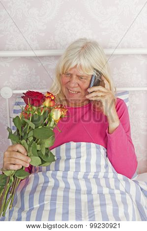 Woman In Bed With Roses And Telephone