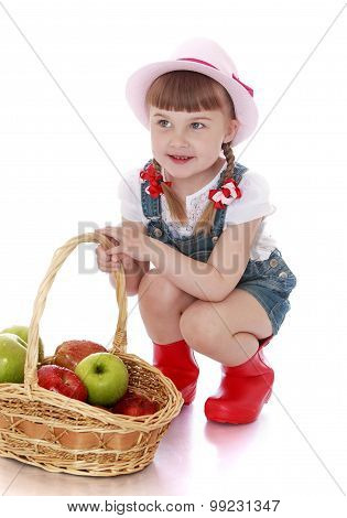 Girl with basket of apples