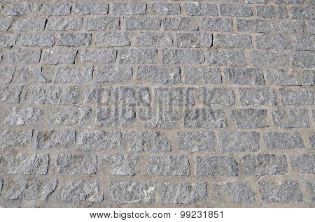 Grey cobbled paving.