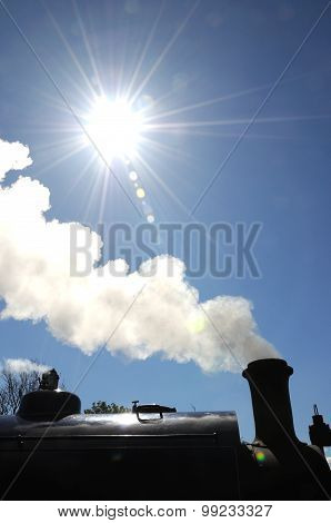 Steam train silhouetted.