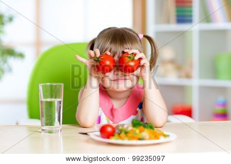 little girl playing with vegetables