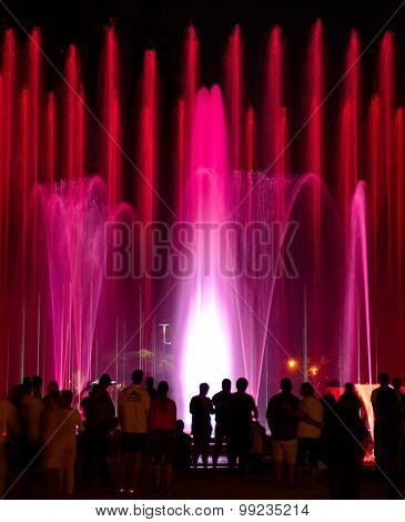 Budapest, Hungary - June 21, 2012: People Watching Beautiful Light-colored Fountains At  Margharet I