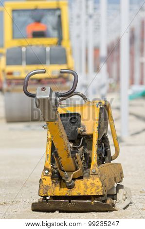 Vibrating Plate Compactor At Construction Site