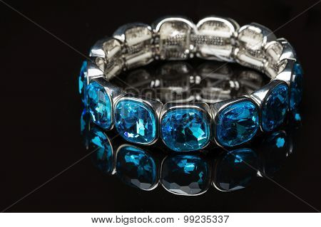 Bracelet with blue stones over black