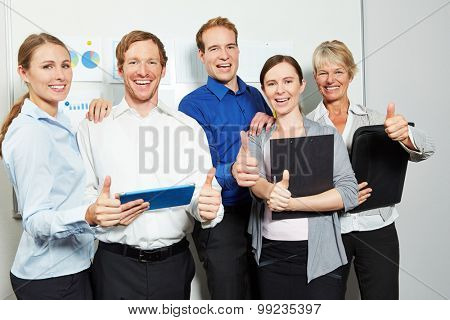 Successful business people team in office holding many thumbs up