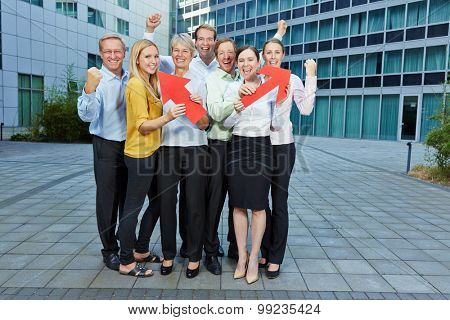 Cheering business people team with red arrows pointing up