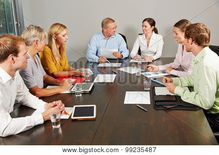 Group of business people negotiating in a conference room