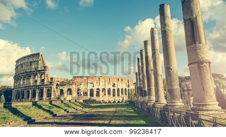 Ancient columns of the Roman temple  near the Coliseum in Rome