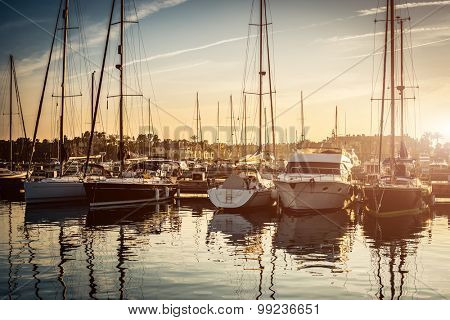 tiful scenery of yachts in a berth with blue clear see and sky background