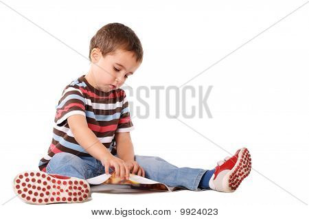 Boy Reading Magazine