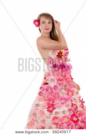 attractive woman in a dress from flowers