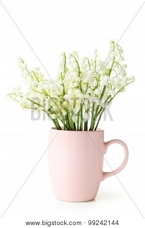 Lily Of The Valley In Cup On White Background
