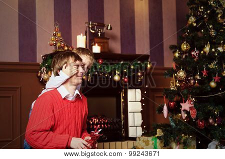 father and son giving presents on Christmas