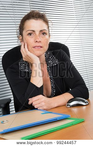 Confident Businesswoman Posing On A Table