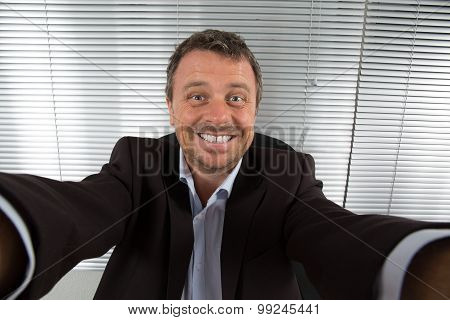 Handsome  Man At Work Taking Selfie