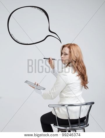 woman writes in a painted bubble