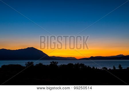 Colorful Evening Blue Hour Sunset Over The Mountains And A Lake