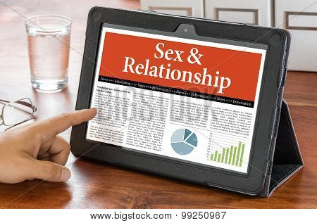 A Tablet Computer On A Desk - Sex And Relationship