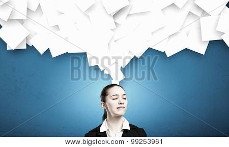 Young businesswoman with closed eyes thinking something over
