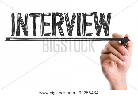 Hand with marker writing the word Interview