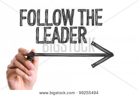 Hand with marker writing the word Follow The Leader