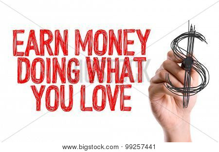 Hand with marker writing the word Earn Money Doing What You Love