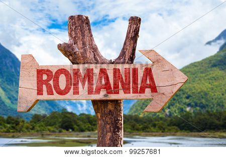 Romania wooden sign with mountains background