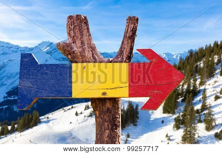 Romania Flag wooden sign with winter background