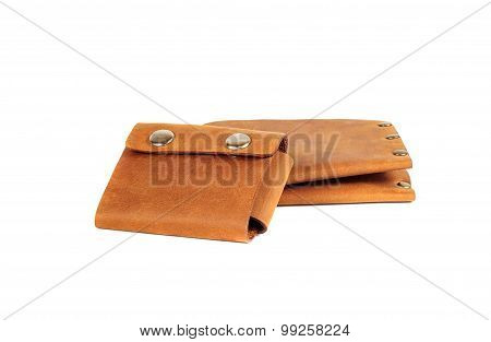 Two brown leather accessories on a white background