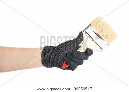 Hand holding a paint brush, isolated
