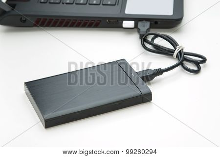 External Hard Disk Connect To Computer Notebook On White.
