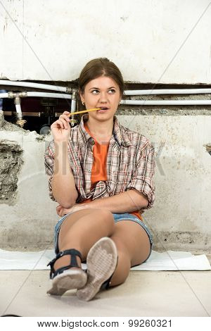 Woman Planning Repairing Pipes