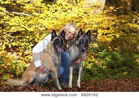 blond woman with two Belgian shepherds