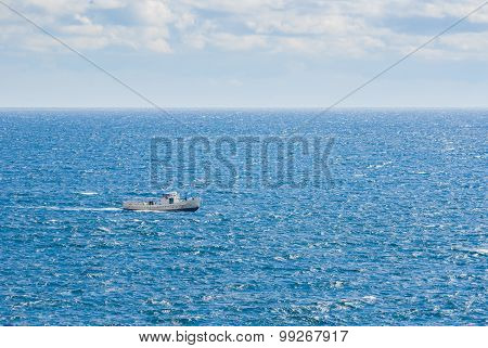 Boundless blue sea and lonely ship