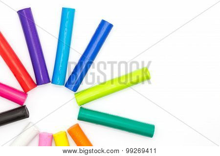 Colorful plasticine clay on white background