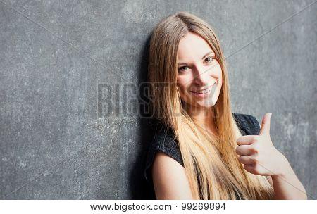 Attractive teenage girl showing thumbs up