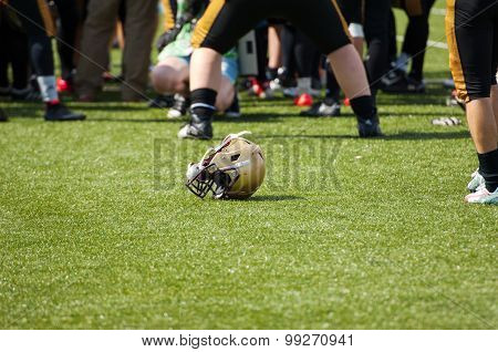 Helmet On The Grass