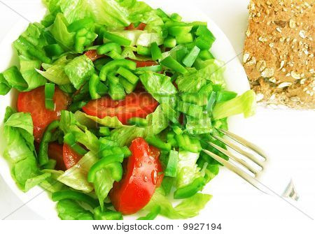 Healthy Vegetarian Salad And Bread On The White Plate