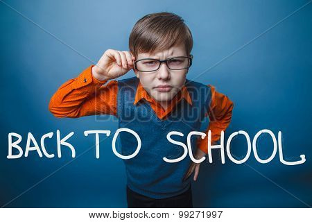 European-looking boy of ten years in glasses, anger, resentment