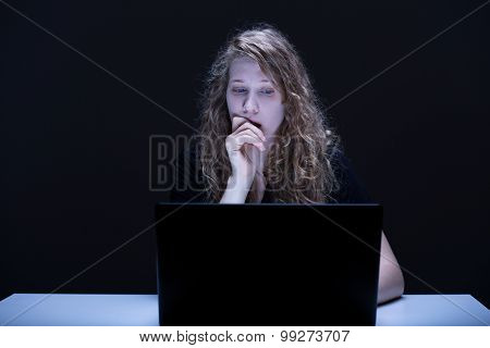 Frightened Female Using Computer