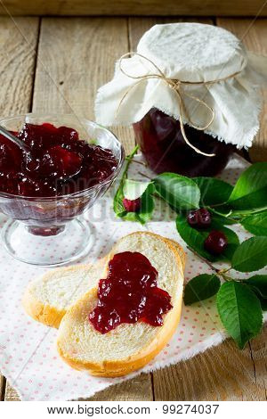 Cherry Jam Jam In The Bank On A Wooden Table