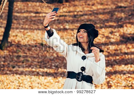 Young Woman Taking Selfie In The Park