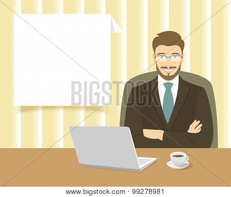 Businessman Sitting At The Office Desk