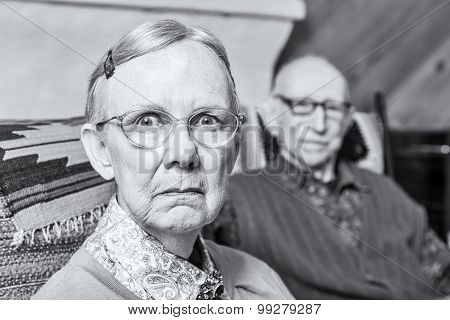 Scowling Elderly Couple