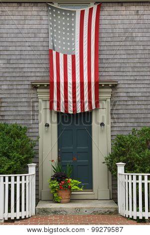 American Flag Hanging Over A Door