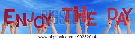 People Hands Holding Red Word Enjoy The Day Blue Sky