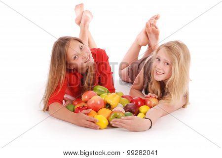 Two Girls Holding Fresh Fruits