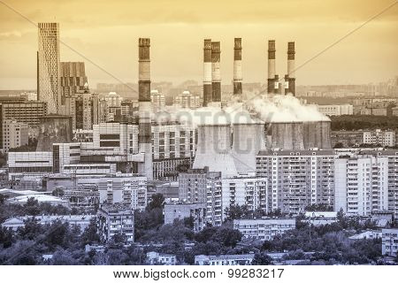 Power Station On The City District Background.