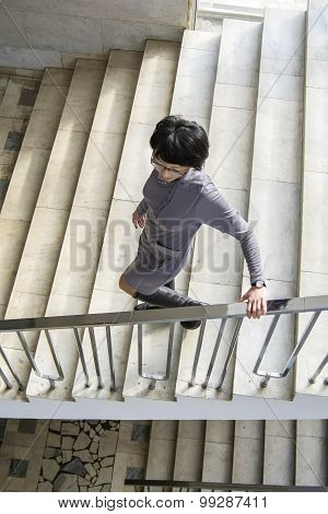 Woman Is On The Stairs