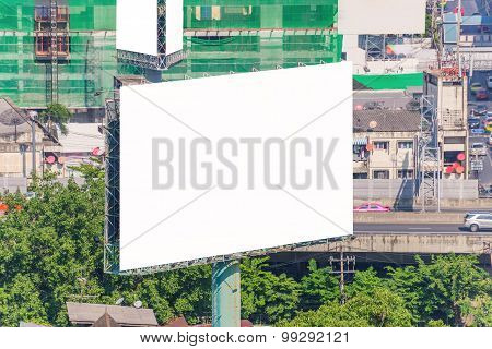 Large Blank Billboard On Overpass With City View Background.